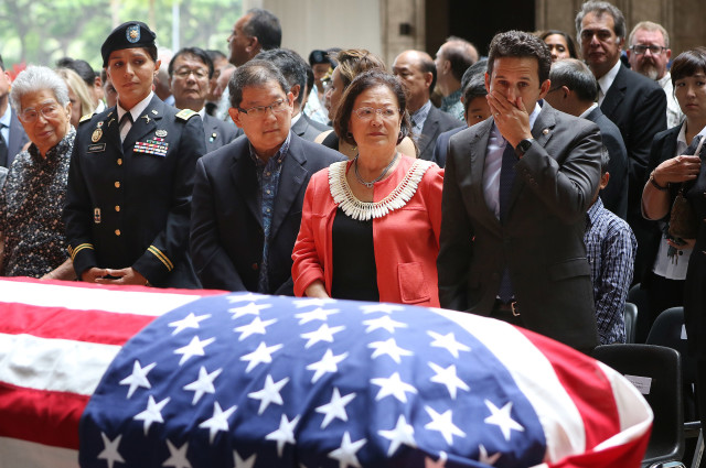 Hawaii congressional delegation left, Senator Dan Akaka, Congresswoman Tulsi Gabbard, Sen Hirono's husband Leighton Oshima, Senator Mazie Hirono and right, Senator Brian Schatz stand during memorial services for Congressman K. Mark Takai at the Hawaii State Capitol Rotunda. 18 aug 2016