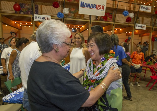 Former U.S. Rep. Colleen Hanabusa, center, who is running for the 1st Congressional District seat is greeted by her supporters with lei after arriving at her campaign election headquarters, Saturday, Aug. 13, 2016, in Honolulu. Photo by Eugene Tanner