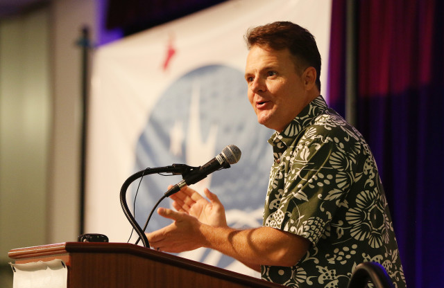 Hawaii Democratic Party Chair Tim Vandeveer introduces Brian Schatz at the annual Democratic Party Unity breakfast at Dole Cannery ballroom. 14 aug 2016