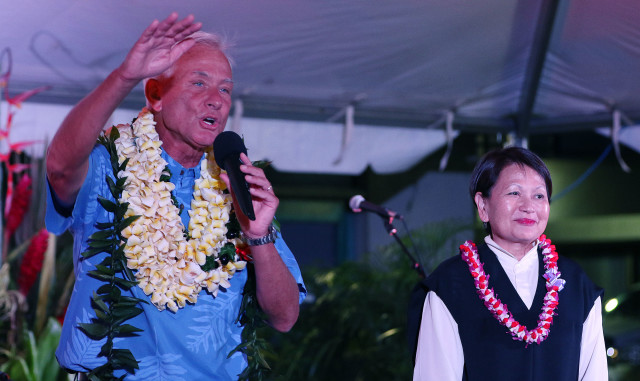 Mayor Kirk Caldwell with wife Donna Tanoue on stage after second printout at headquarters. Caldwell was leading Djou. 13 aug 2016