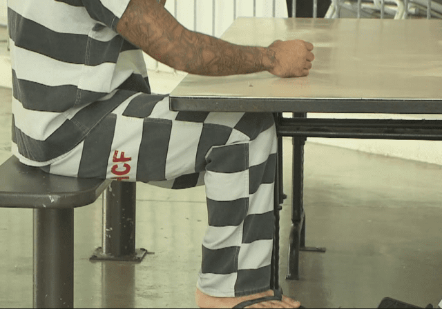 A prisoner at the Halawa Correctional Facility in a striped uniform, based on designs from the 19th century when the outfits were conceived as badges of shame.