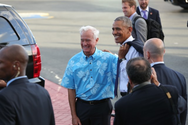 President Obama poses for a photo with Honolulu Mayor Kirk Caldwell after landing Wednesday.
