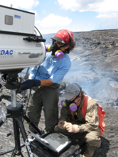 Jeff Sutton and Tamar Elias, both of the USGS Hawaiian Volcano Observatory, set up a spectrometer, an instrument that detects gas compositions on the basis of absorbed infrared light.