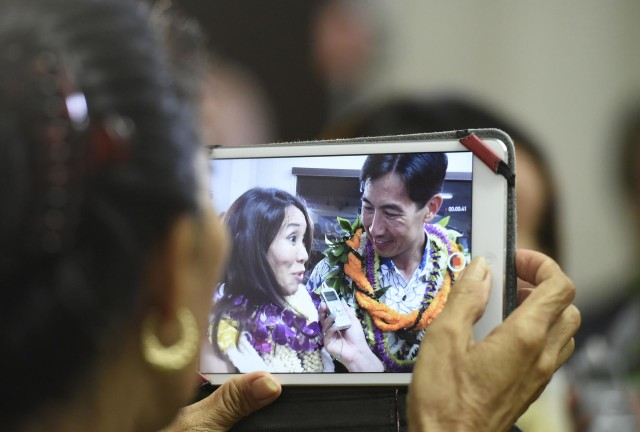 Charles Djou stands with his wife Stacey during the celebration party for his Honolulu Mayor election Saturday, August 13, 2016. (Civil Beat photo by Ronen Zilberman)