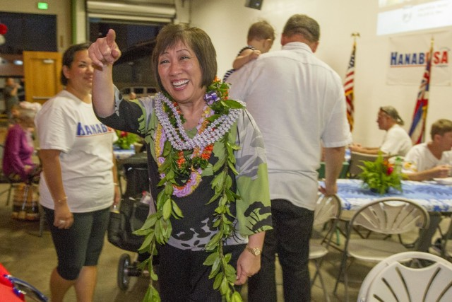 Former U.S. Rep. Colleen Hanabusa, right, who is running for the 1st Congressional District seat is greeted by her supporters after arriving at her campaign election headquarters, Saturday, Aug. 13, 2016, in Honolulu. Photo by Eugene Tanner