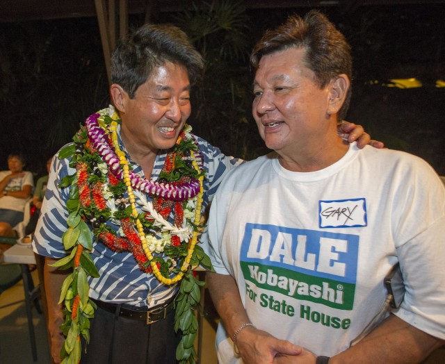 Hawaii State House of Representative District 23 Candidate Dale Kobayashi, let, talks with Gary Maeshiro, right, at his campaign party with his supporters Saturday, Aug. 13, 2016, in Honolulu. Photo by Eugene Tanner