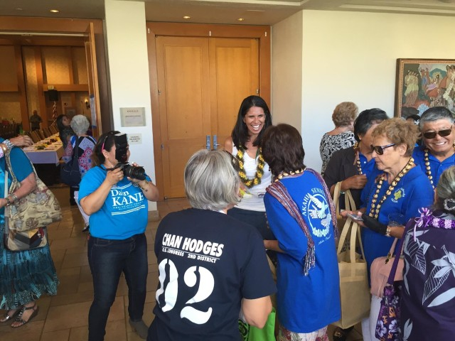 Shay Chan Hodges talks to supporters at the Maui Economic Opportunity senior fair.