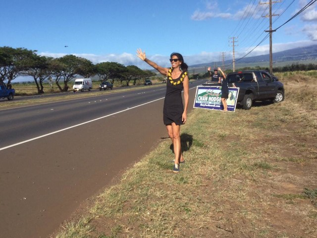 Shay Chan Hodges, Democratic candidate for Congress, waves along Hana Highway on Maui.