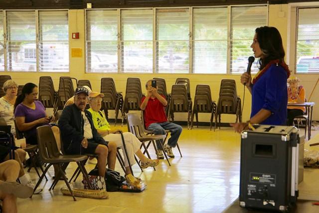 Tulsi Gabbard talks to kupuna during a meeting with the Kailua Seniors Club, Wednesday.