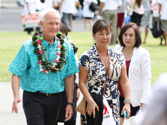 Glenna Wong walks with Mayor Caldwell after sign waving fronting Honolulu Hale with Mayor Caldwell, Deputy Managing Director Georgette Deemer. 4 may 2016