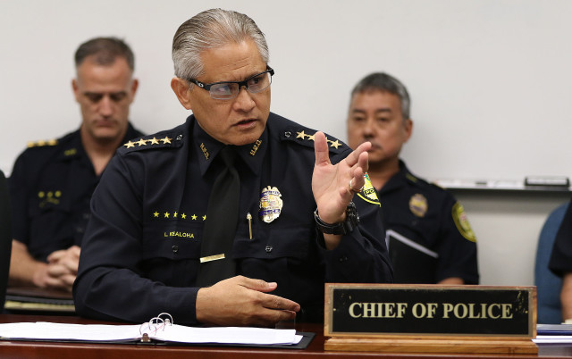 HPD Chief Louis Kealoha gestures as HPD Commissioner Sheehan questions him. 7 sept 2016