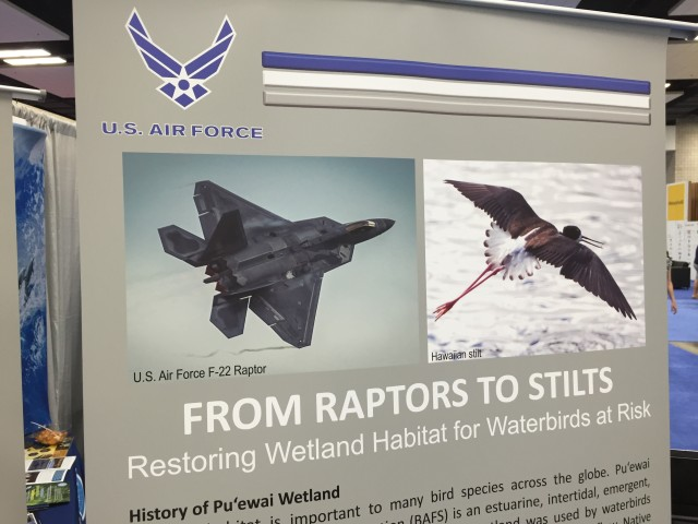 A poster at an Air Force exhibit at the IUCN meeting at the Hawaii Convention Center.