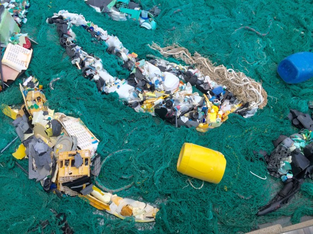 An exhibit at the International Union for Conservation of Nature held recently in Honolulu demonstrates the buildup of plastic debris in the ocean.