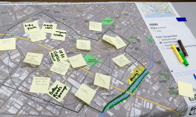 "Community members create a ""wish map,"" writing what they wish to see in a particular area of Kalihi."