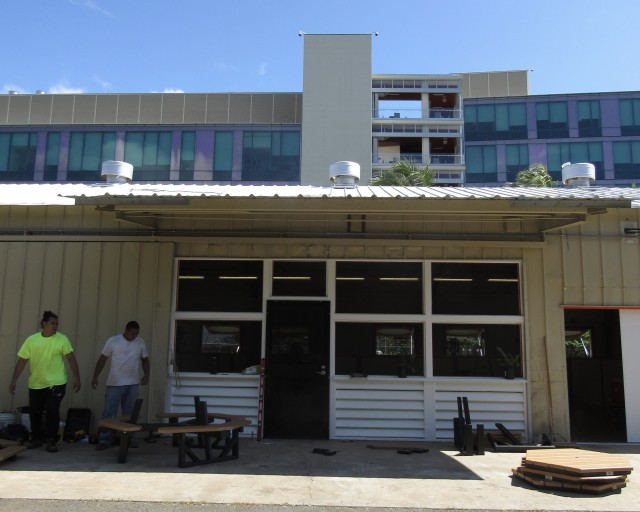 To keep the heat down during the day, spray foam insulation and heat exhaust fans were added to the interior roof of the Kakaako Family Assessment Center.