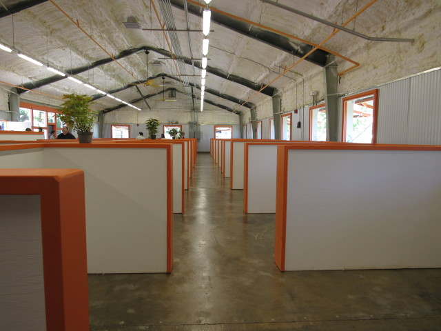 The inside of the Kakaako Family Assessment Center has cubicles to accommodate families and is trimmed with orange.