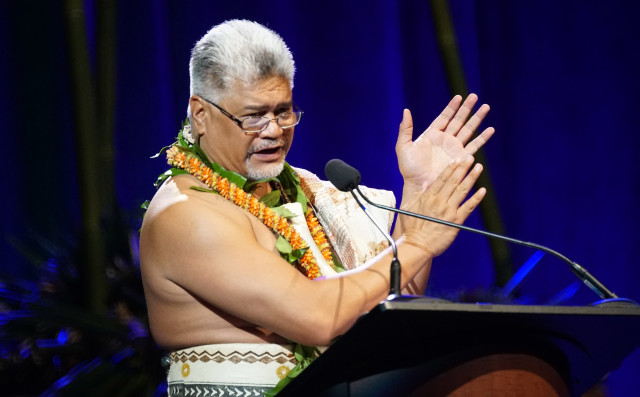 Master of Ceremonies Kamanaopono Crabbe, Office of Hawaiian Affairs CEO, at the start of IUCN opening ceremonies ask audience to greet the next person sitting next to them and give them a hug too. 1 sept 2016