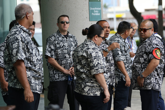 IUCN Protest HPD officers dressed in aloha shirts fronting the Hawaii Convention Center. 3 sept 2016