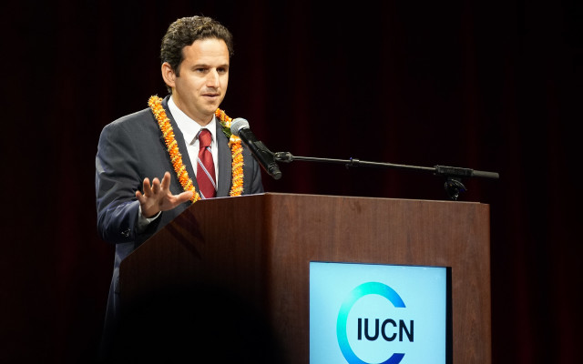 Senator Brian Schatz speaks to attendees at the IUCN opening ceremonies held at the Neal Blaisdell Arena.