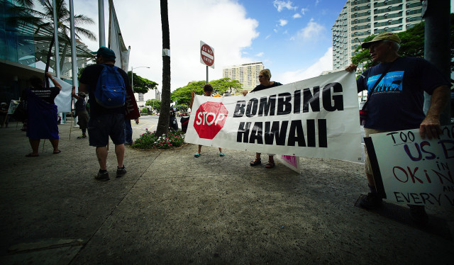 Demonstrators holds sign 'Stop bombing Hawaii' at the IUCN congress at the Hawaii Convention Center. 3 sept 2016