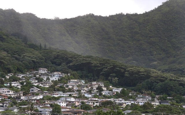 Homes at the back of Manoa valley abutted against a treeline with Koolau Mountains in the background. 9 sept 2016