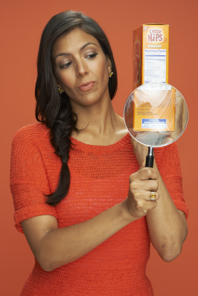 Vani Hari reads a package's list of ingredients in a promotional photo.