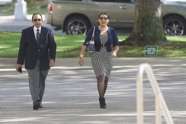 Anosh Yaqoob walks with his sister, Roheeni Yaqoob.