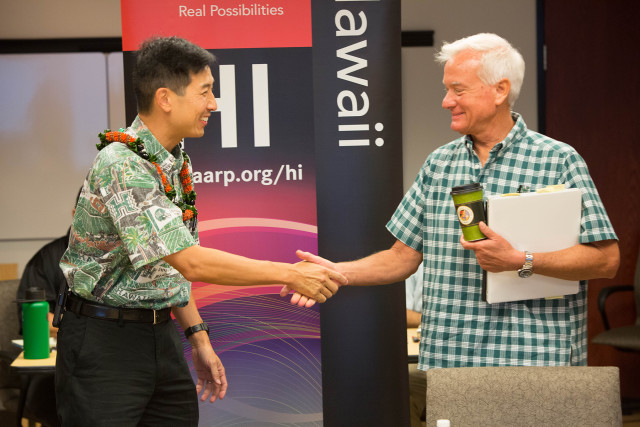 Kirk Caldwell and Charles Djou shake hands before starting AARP Hawaii's tele-town hall. Saturday, October 1, 2016