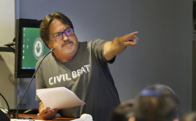 Chad Blair gestures during Civil Cafe Election Trivia held at the University of Hawaii at Manoa campus. 3 nov 2016