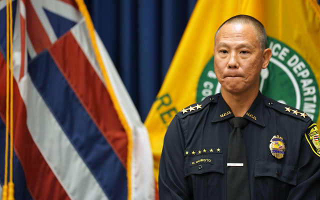 HPD Acting Chief Cary Okimoto looks on as Acting Mayor Roy Amemiya speaks to media during presser at HPD headquarters. 20 dec 2016