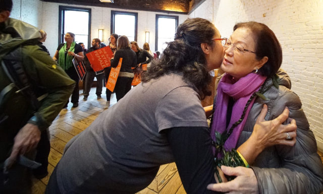 Hilo resident Jennifer Kagiwada gives Sen Mazie Hirono a ti leaf lei before march at Stanton and Greene. Washington DC. 21 jan 2017