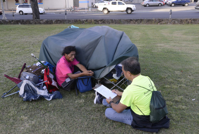 James Upon is intervieed survey volunteers outside is tent in the Old Stadium Park as volunteers begin collecting information about the homeless population in Honolulu Monday, January 23, 2017. (Civil Beat photo Ronen Zilberman)