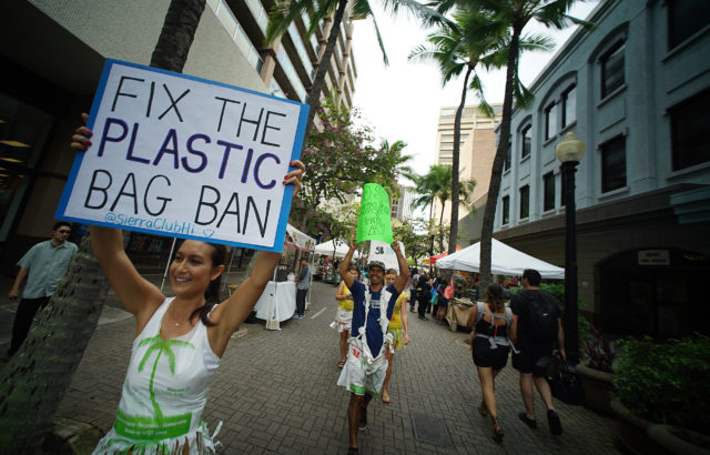 Jodi Malinoski leads marchers up Fort Street mall towards Pali Longs Drugs to encourage the City to close the loophole in the plastic bag ban and the State to pass a ban on syrofoam food containers. 10 feb 2017