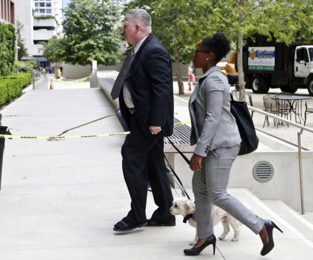FILE - In this June 9, 2016 file photo Rear Adm. Robert Gilbeau enters the federal courthouse in San Diego. Gilbeau was sentenced Wednesday, May 17, 2017 in federal court in San Diego after pleading guilty to one count of making false statements. Gilbeau the first active-duty U.S. Navy admiral ever convicted of a federal crime was sentenced to 18 months in prison for lying to investigators about a Malaysian defense contractor at the center of a massive corruption scandal. (AP Photo/Lenny Ignelzi,File)