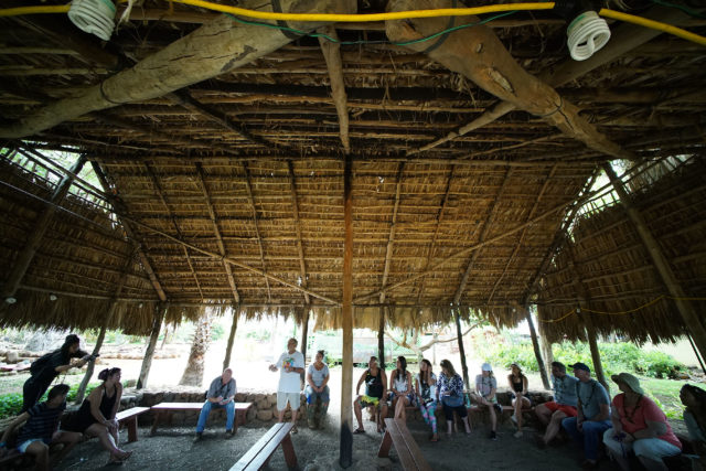 Luigi Gigi Cocquio from Hoa Aina O Makaha shares some thoughts during a tour by visiting journalists from the continental US, Gigi spoke about how this very thatched 'hale' was burned down three times and they rebuilt it each time trying not to be negative, being positive and moving forward. 30 may 2017