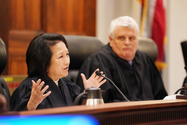Left, Associate Justice Paula Nakayama raises questions during Civil Beat case with right,Chief Justice Mark Recktenwald, looking on. 1 june 2017