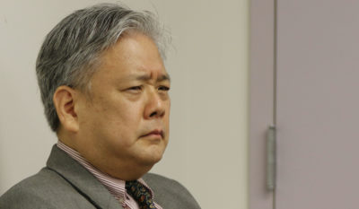 Embattled ex HPD Police Chief attorney Kevin Sumida sits in HPD Police Commission meeting.
