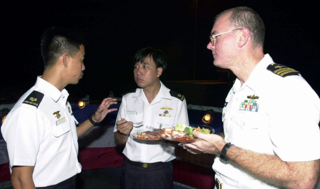 Republic of Singapore Navy (RSN) Major (MAJ) Danny Tan, (left), RSN (MAJ) H .C. Lim, (center) and US Navy (USN) Commander (CDR) Dave Kapaun (right), at a reception onboard the USN dock landing ship USS RUSHMORE (LSD 47) during the seventh annual COOPERATION AFLOAT READINESS AND TRAINING (CARAT) Exercise 2001.