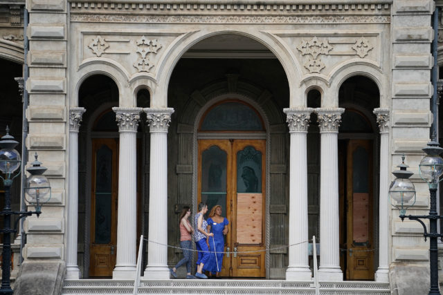 Visitors enter the mauka side of Iolani Palace after someone damaged mauka side doors, breaking the glass on 3 different doors. 2 june 2017