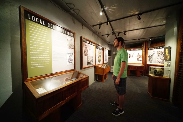 Philadelphia resident Matthew Owens checks out some Vietnam photographs, some made by Denby Fawcett at the US Army Museum in Waikiki.