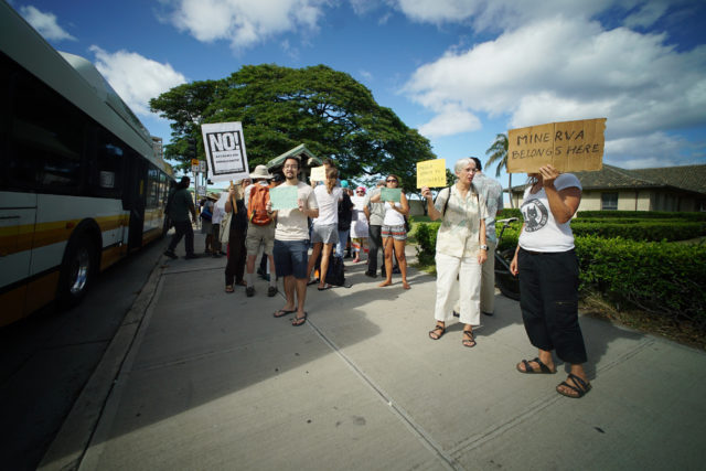 Supporters Minerva Martinez stand and hold signs at ICE Homeland Security building located at 595 Ala Moana Blvd. 7 june 2017