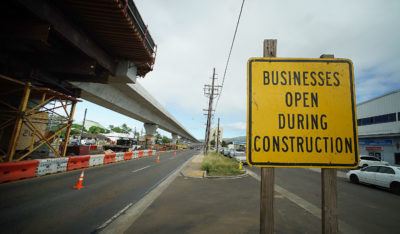 Sign reads 'Businesses still open' on the mauka side of Farrington Highway in Waipahu near Jack in the Box.