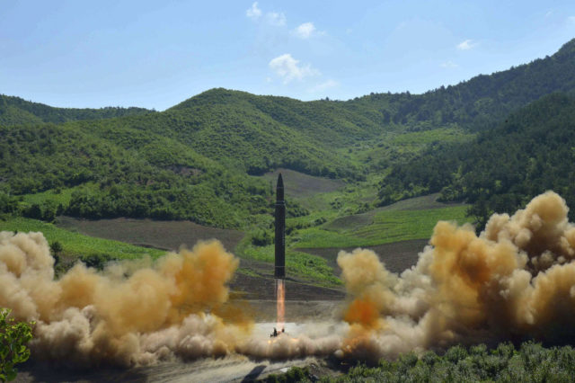 """FILE - This July 4, 2017 file photo, distributed by the North Korean government shows what was said to be the launch of a Hwasong-14 intercontinental ballistic missile in North Korea. Hawaii is the first state to prepare the public for the possibility of a ballistic missile threat from North Korea. The state's Emergency Management Agency on Friday, July 21, 2017 announced a public education campaign. Agency Administrator Vern Miyagi says because it would take a missile about 15 minutes to arrive, there won't be much time to prepare. He says that's why instructions are simple: """"Get inside, stay inside and stay tuned."""" (Korean Central News Agency/Korea News Service via AP, File)"""