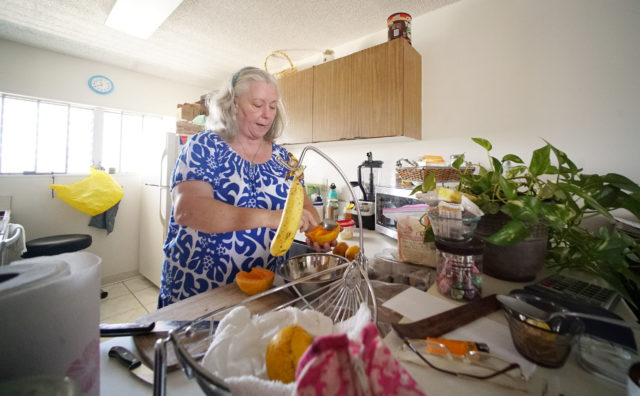 Jewell Domingo makes a fruit salad for her brother who has health issues.
