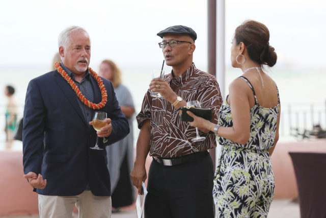 Nick Denzer chats with Senator Will Espero at Blake Tek Yoon's gala event to sell his house held at the Royal Hawaiian Hotel.