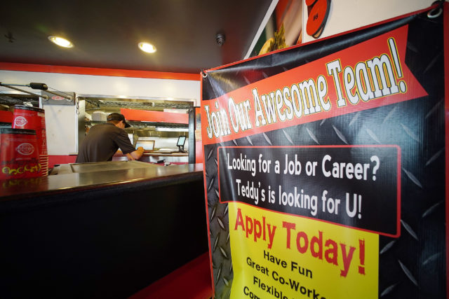 Sign inside Teddy's Bigger Burger located in Hawaii Kai sign denoting 'Join Our Awesome Team'.