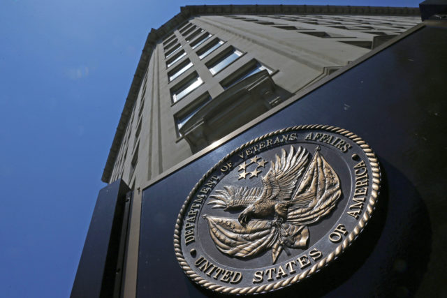 FILE - In this June 21, 2013, file photo, the seal affixed to the front of the Department of Veterans Affairs building in Washington. Congress sent President Donald Trump legislation to provide the biggest expansion of college aid for military veterans in a decade. The Senate cleared the bill by voice vote on Aug. 2, 2017, the second piece of legislation aimed at addressing urgent problems at the beleaguered Department of Veterans Affairs in as many days. The House passed the bipartisan college aid legislation last week.(AP Photo/Charles Dharapak, File)