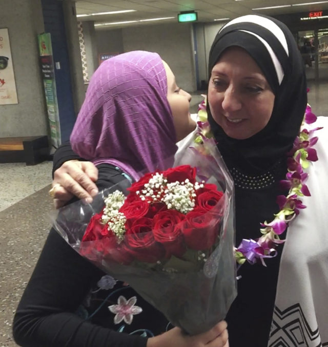 Noran Elshikh, left, greets her grandmother Wafa Yahia at Honolulu's Daniel K. Inouye International Airport after she arrived from Syria on Saturday, Aug. 12, 2017. Ismail Elshikh is a plaintiff in Hawaii's challenge to the travel ban. The lawsuit argues that the ban prevented Wafa Yahia, his Syrian mother-in-law, from visiting. (Ismail Elshikh via AP)