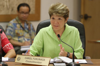 City Council Member Carol Fukunaga listens to testimony against Bill 69 at Honolulu Hale.
