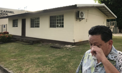 Former Agat, Guam altar boy Roland Paul L Sondia wipes away tears while standing near Father Apuron's priest quarters in Agat, Guam. Sondia was about 12-years when he alleged he was invited into now Archbishop Apuron's room in the evening and sexually abused.